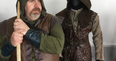 Cosplayer Mark Robinson next to authentic Robin costume